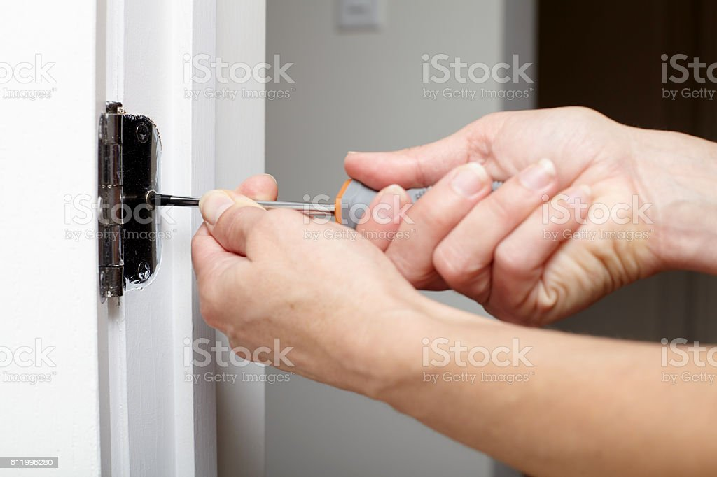 Door hinge installation. stock photo