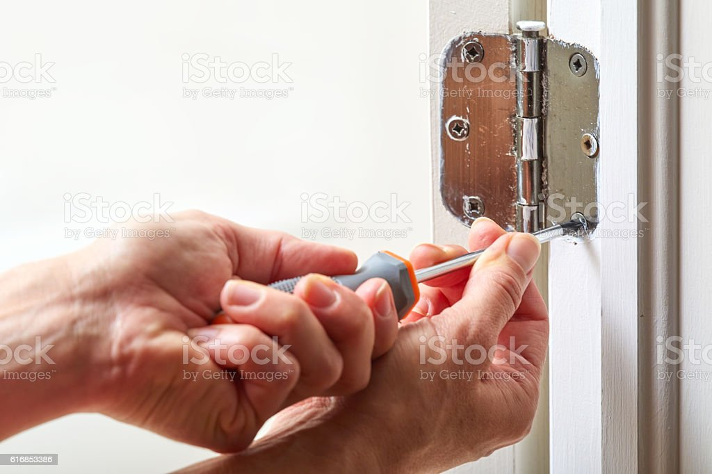 Door hinge installation. stock photo