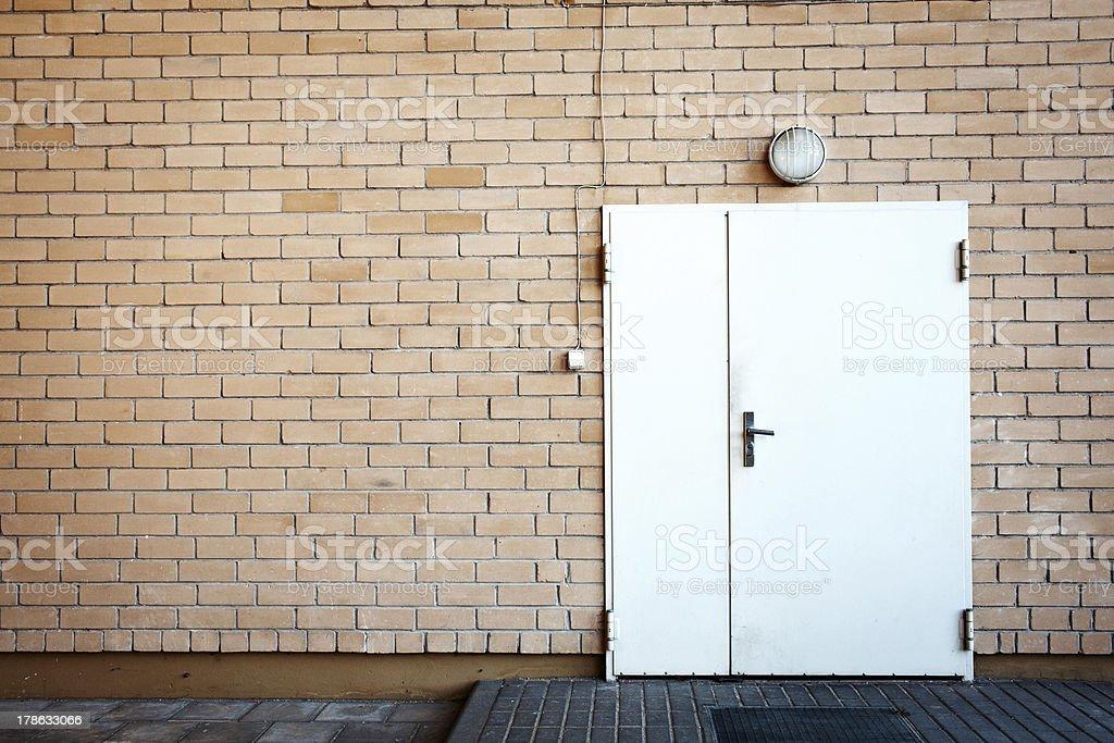 Door in a brick wall royalty-free stock photo