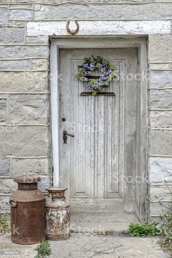 Door in Old Stone House with Horseshoe for Good Luck royalty-free stock photo