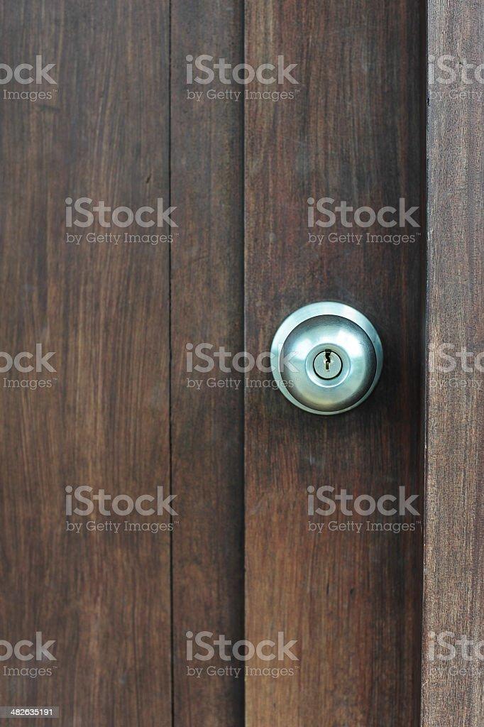 Door knob on wooden door stock photo