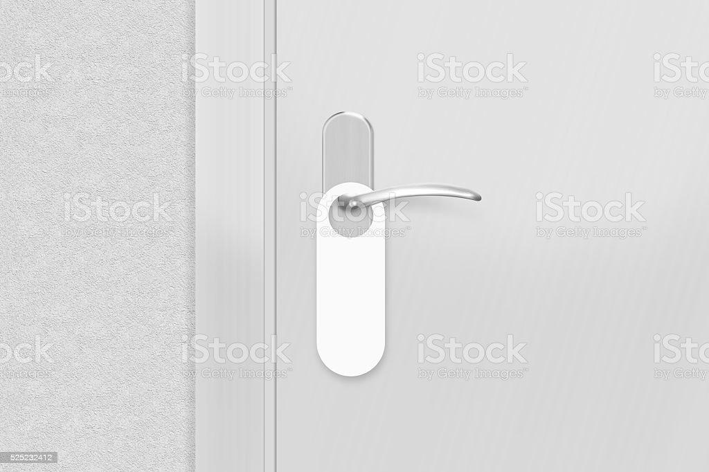 Door knob with blank doorhanger mock up. Empty white flyer stock photo