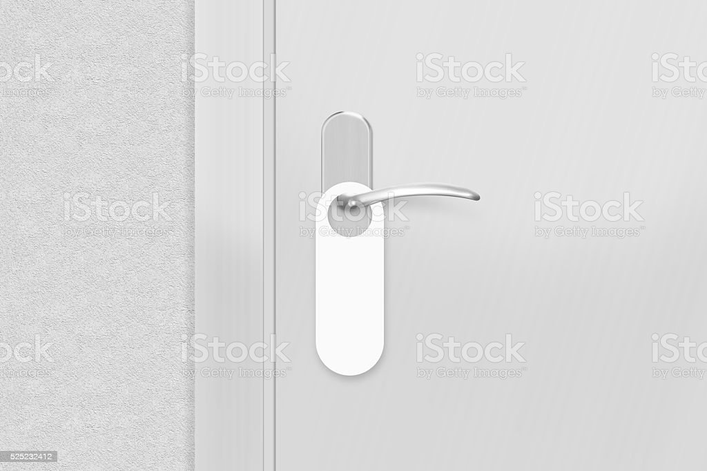 Door knob with blank doorhanger mock up. Empty white flyer stock photo