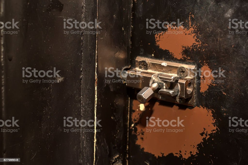 Door latch on wooden surface stock photo