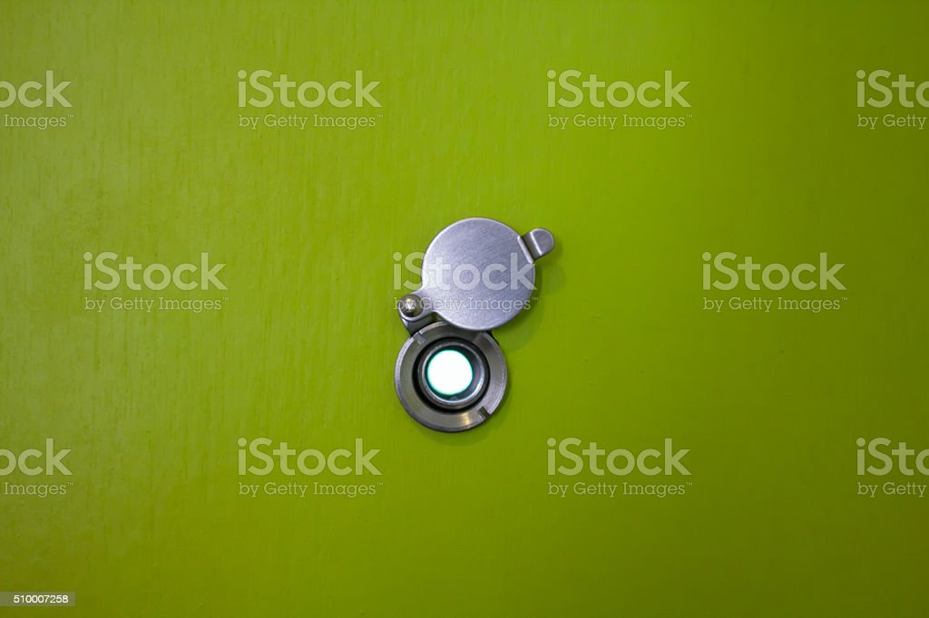 door lens peephole on wooden texture stock photo