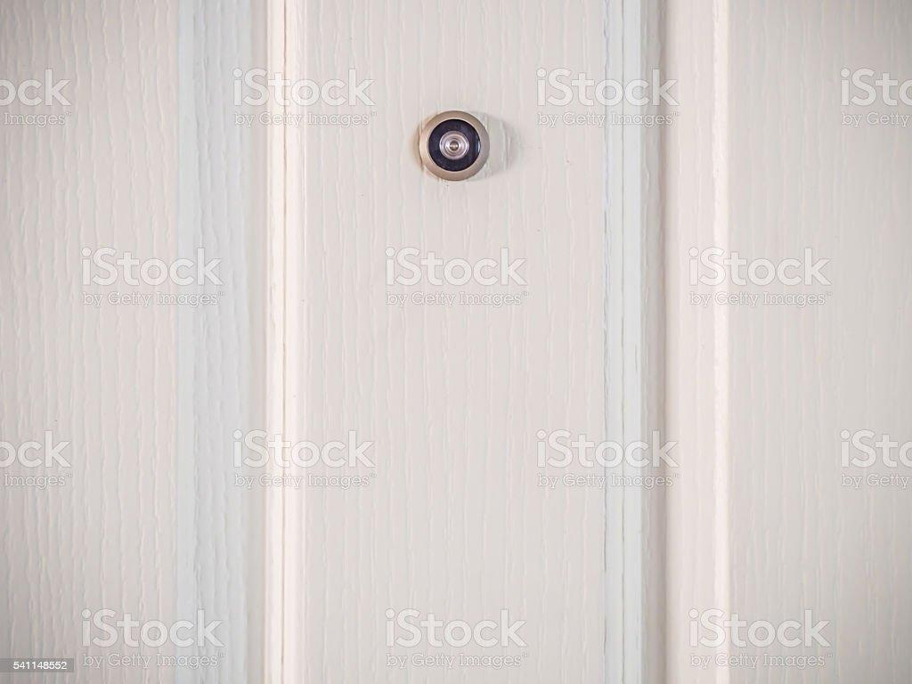 Door lens peephole security on wooden texture stock photo