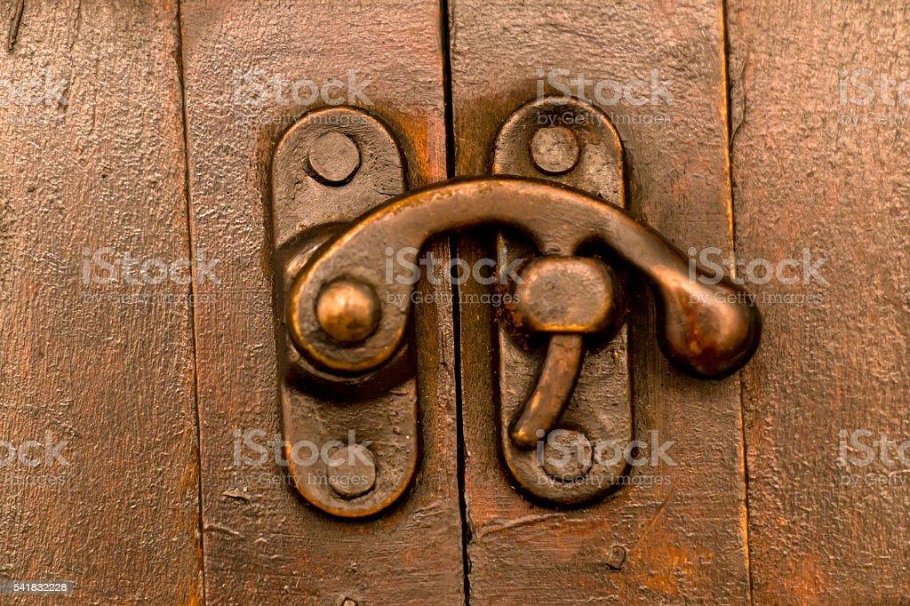 Door Lock on a wooden Gate stock photo