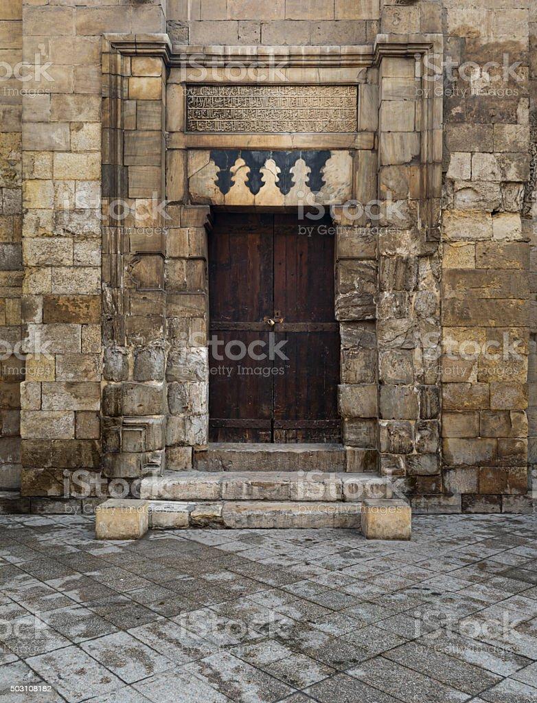 Door of a historic theological school (Arabic: Madrasa) stock photo