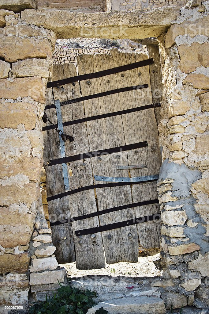 Door of an abandoned house in Chenini, South Tunisia stock photo