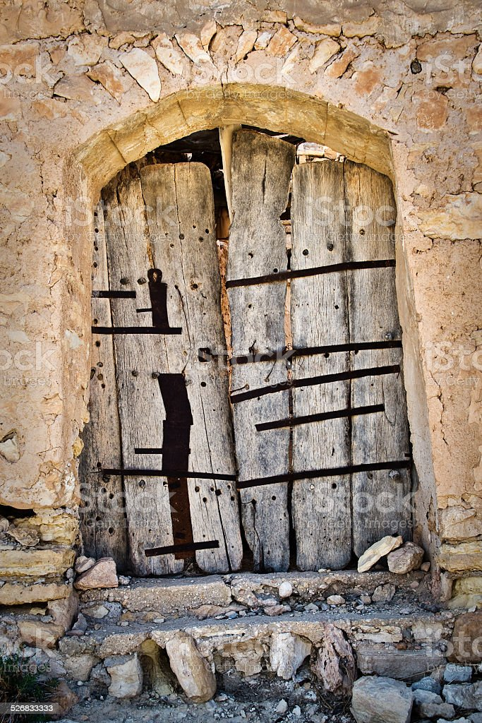 Door of an abandoned house in the village of Chenini stock photo