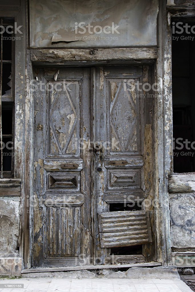Door of an abandoned house royalty-free stock photo