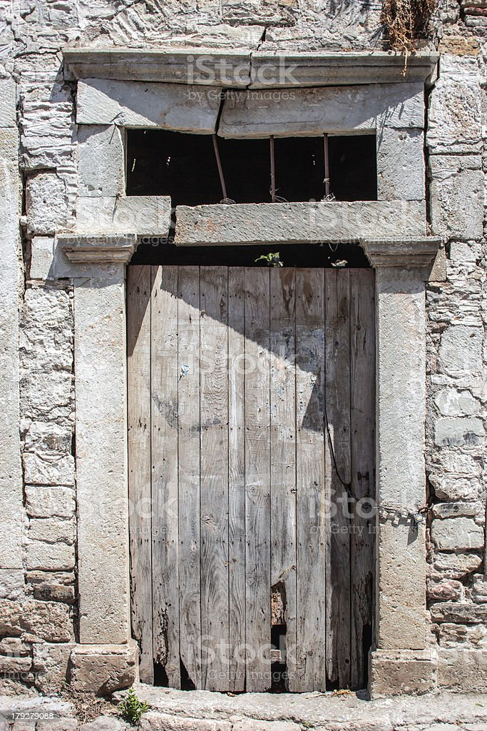 Door of an abandoned house stock photo