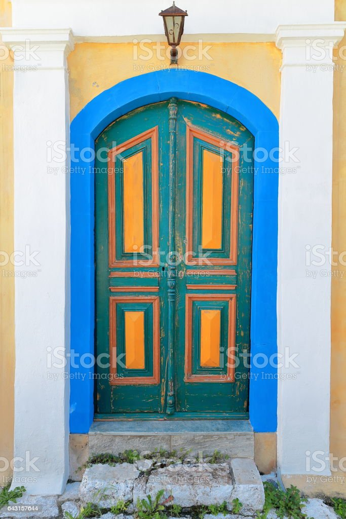 Door of restored house-backstreet of main harbor-town center. Kastellorizo-Greece. 1669 stock photo