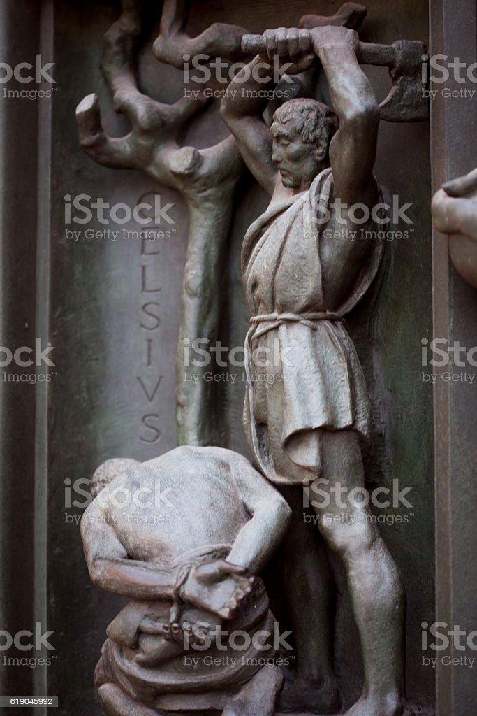 Door of the duome, Milan, executioner executes human. Bronze bas stock photo