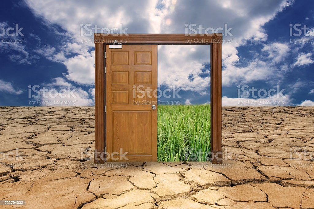 Door on drought land entrance to the rice field stock photo