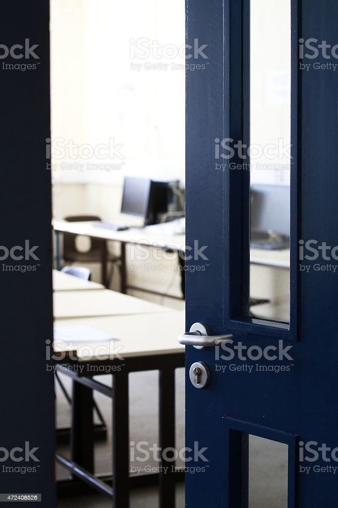 door opening into classroom stock photo