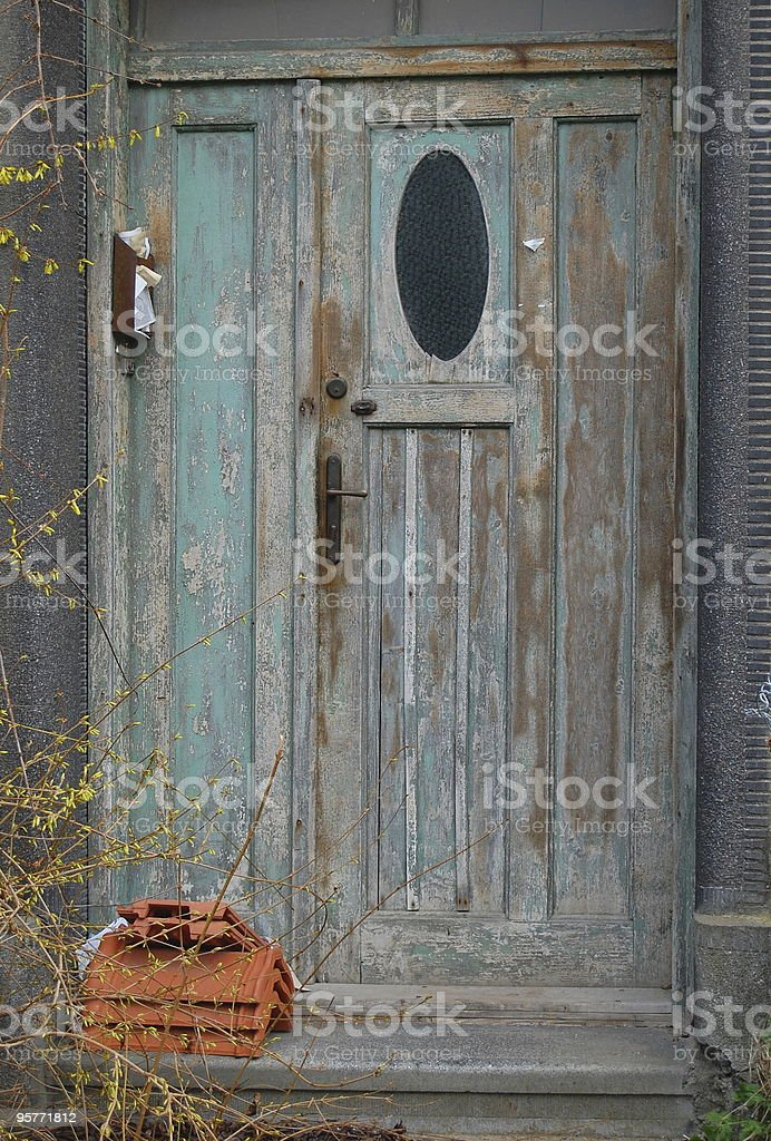 Door to an abandoned house stock photo
