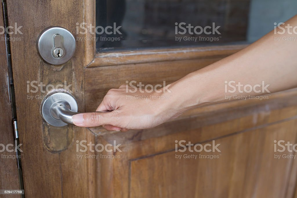 door with a hand on handle stock photo