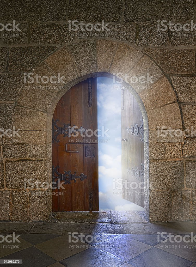 Door with arch opening to a beautiful cloudy sky stock photo