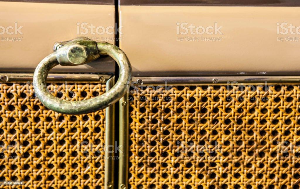 Door with bronze handle and lattice-look weaving cover on stock photo