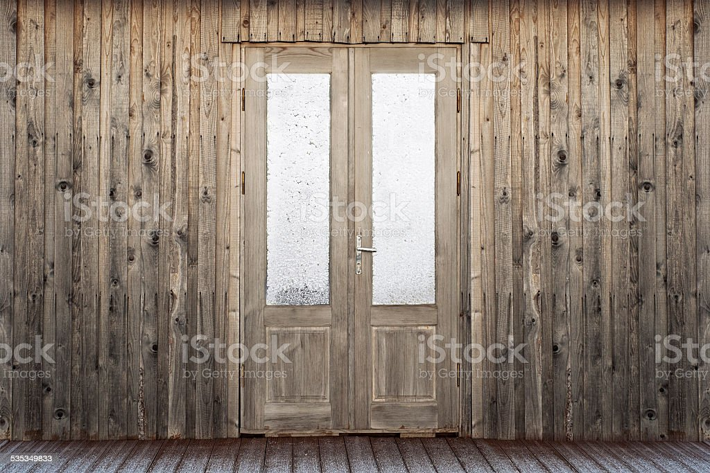 door with frosty window of plank house stock photo