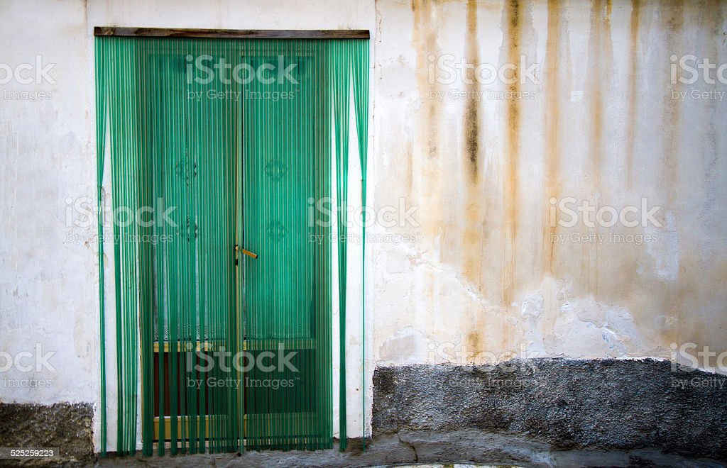 Door With Green Plastic Bead Curtain U0026 Streaked Wall, Sicily Stock Photo