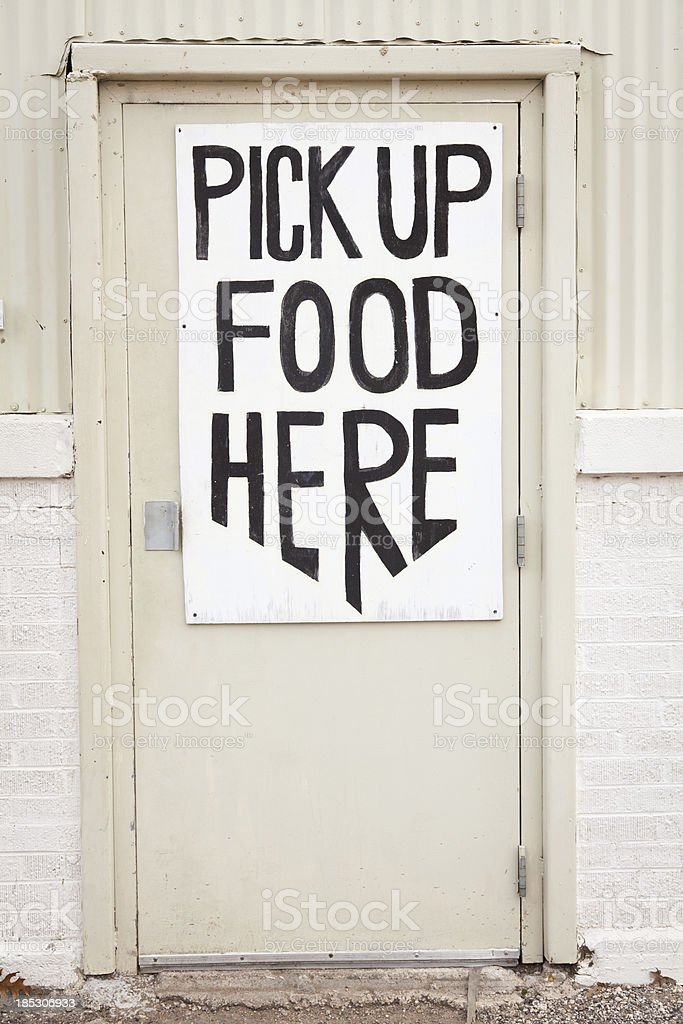 Door with Pick up Food Here sign royalty-free stock photo