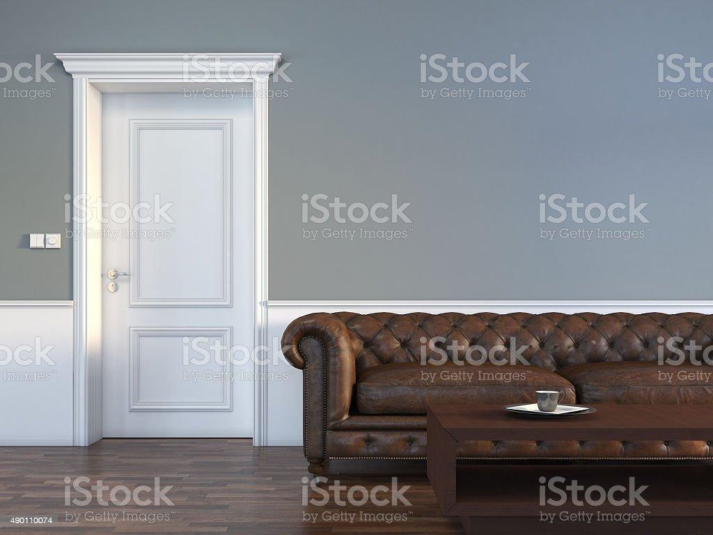 Door with sofa in empty room stock photo