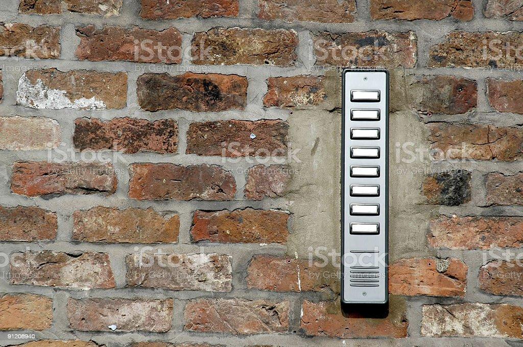 Doorbell on red brick wall royalty-free stock photo