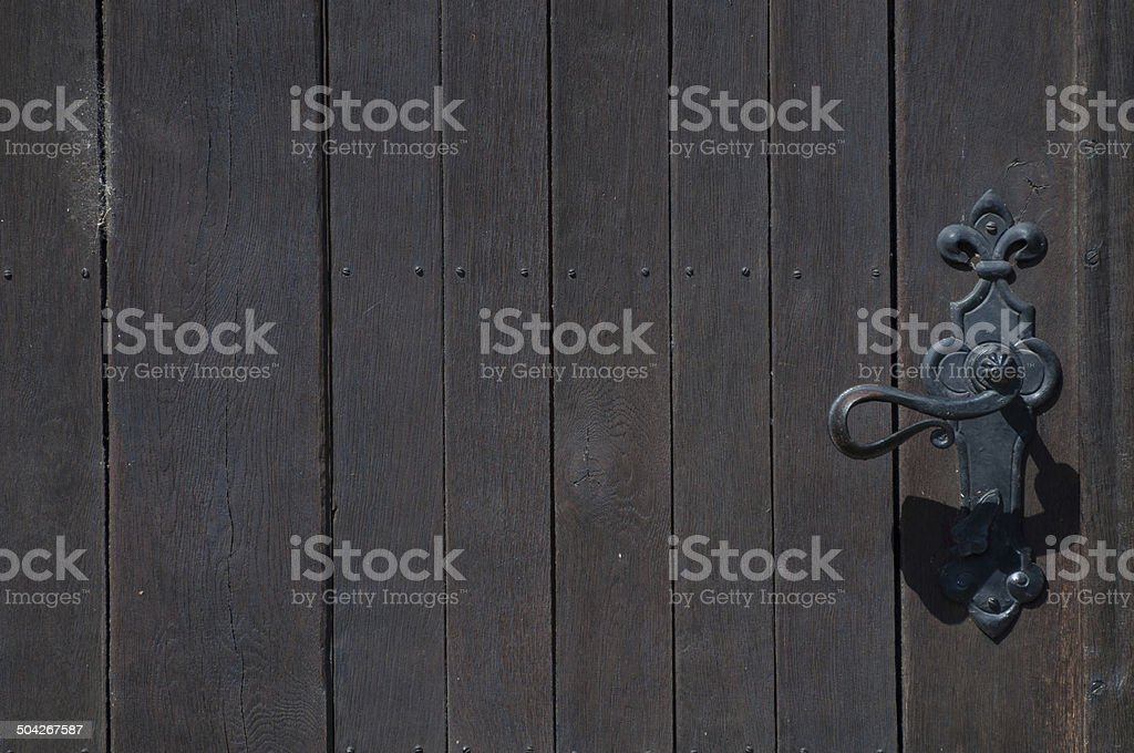 doorknob on the right and brown wooden door royalty-free stock photo
