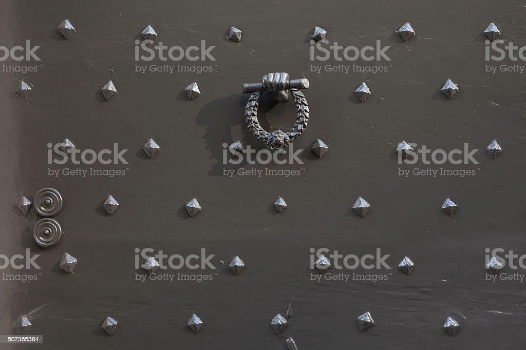 Doorknocker in the shape of a fist holding laurel wreath stock photo