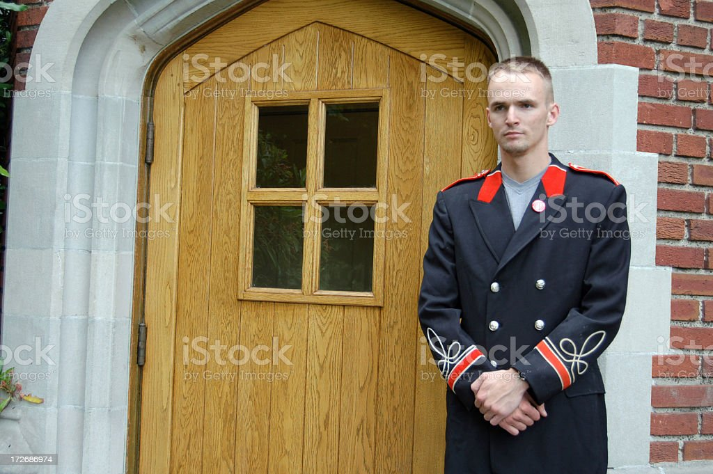 Doorman in Uniform stock photo