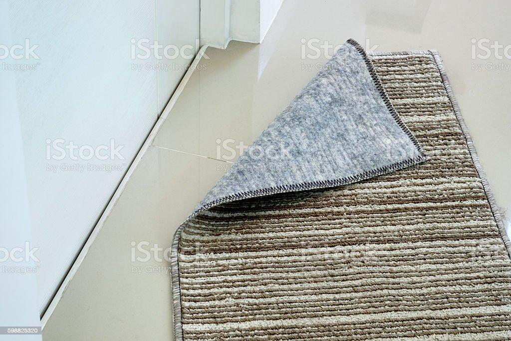 doormat in front of toilet stock photo