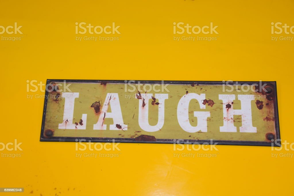 Doormat WITH SIGN 'laugh' stock photo