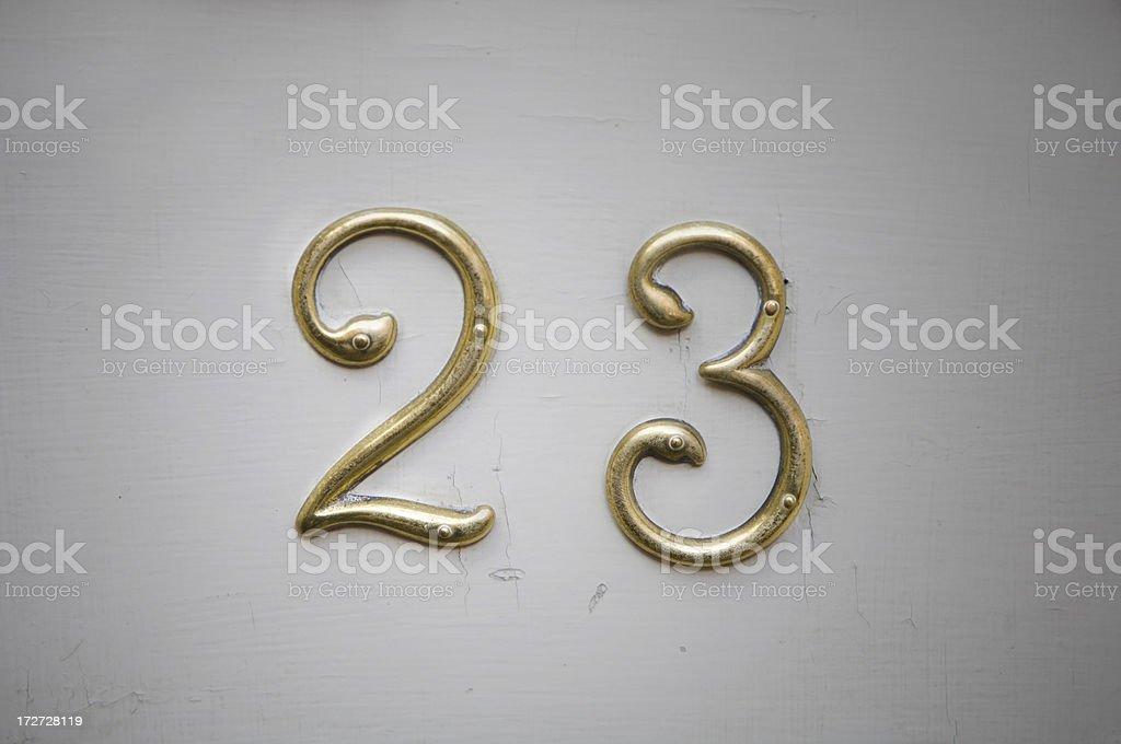 Doorplate with twentythree on it stock photo