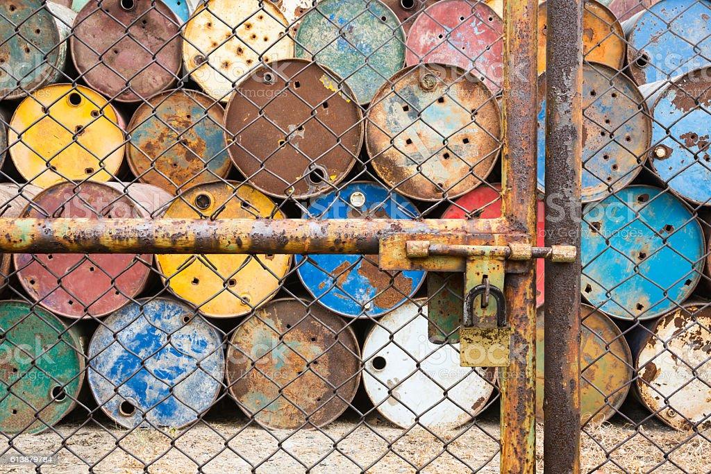 doors locked for old tanks containing hazardous chemicals stock photo