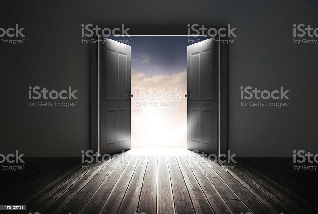 Doors opening to reveal beautiful sky stock photo