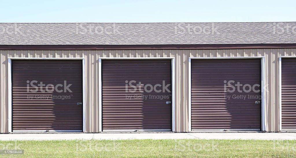 doors to individual garage stalls royalty-free stock photo