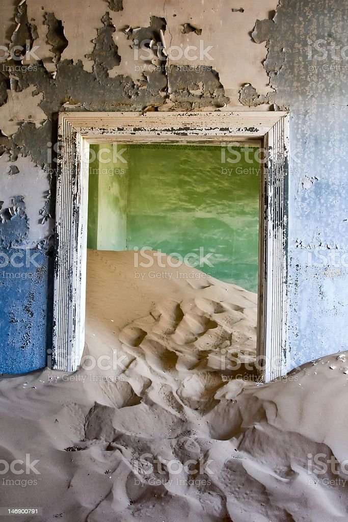 Doorway filled with sand stock photo