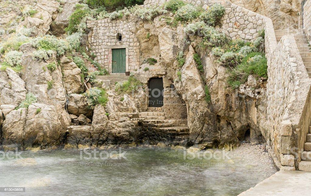 Doorways in the Rocks at Kolorina Bay, Dubrovnik stock photo