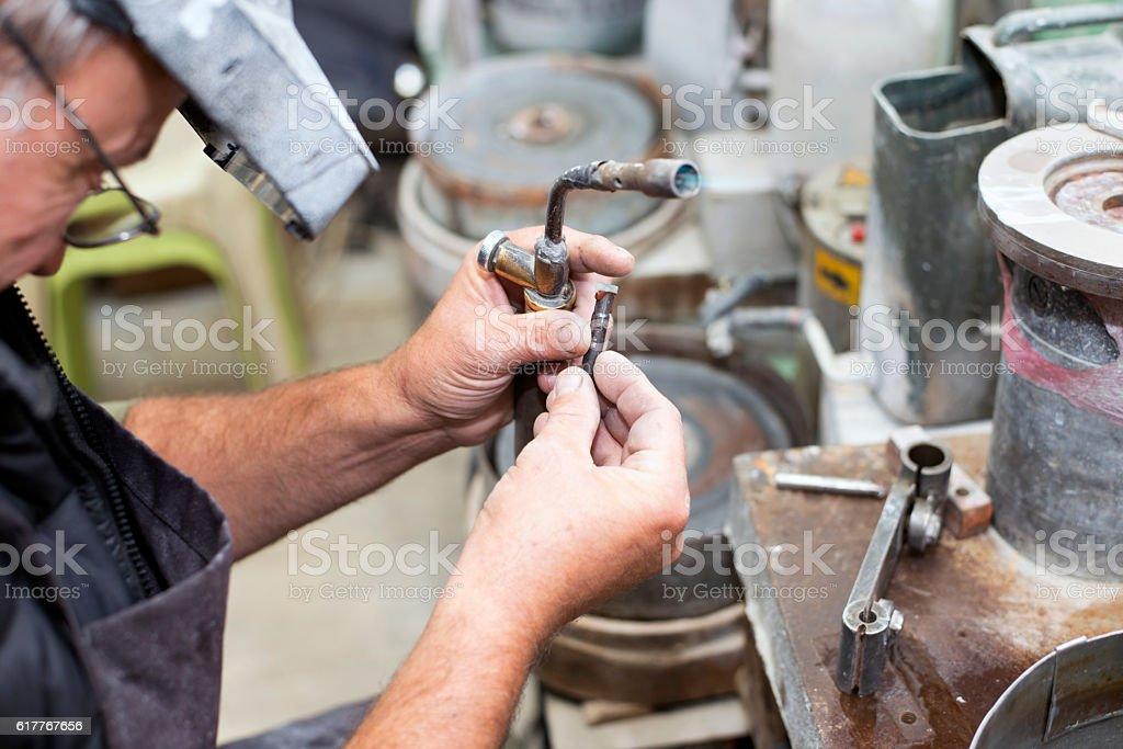 Dopping the gemstone stock photo
