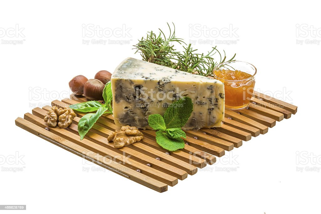 Dor blue cheese with herbs, nuts and honey stock photo