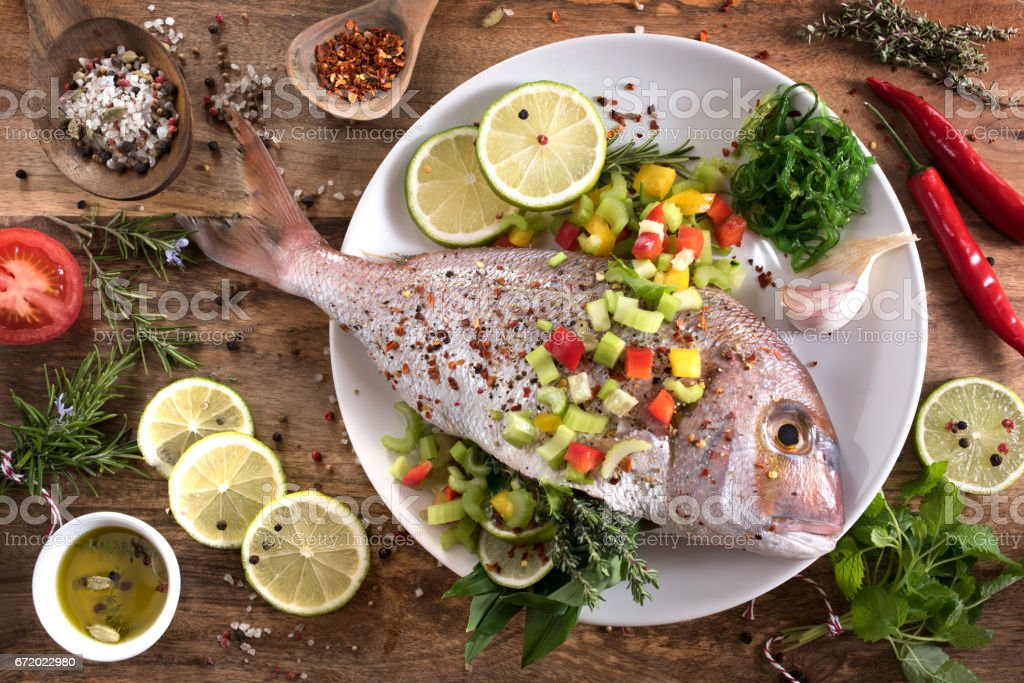 Dorade with herbs filling stock photo