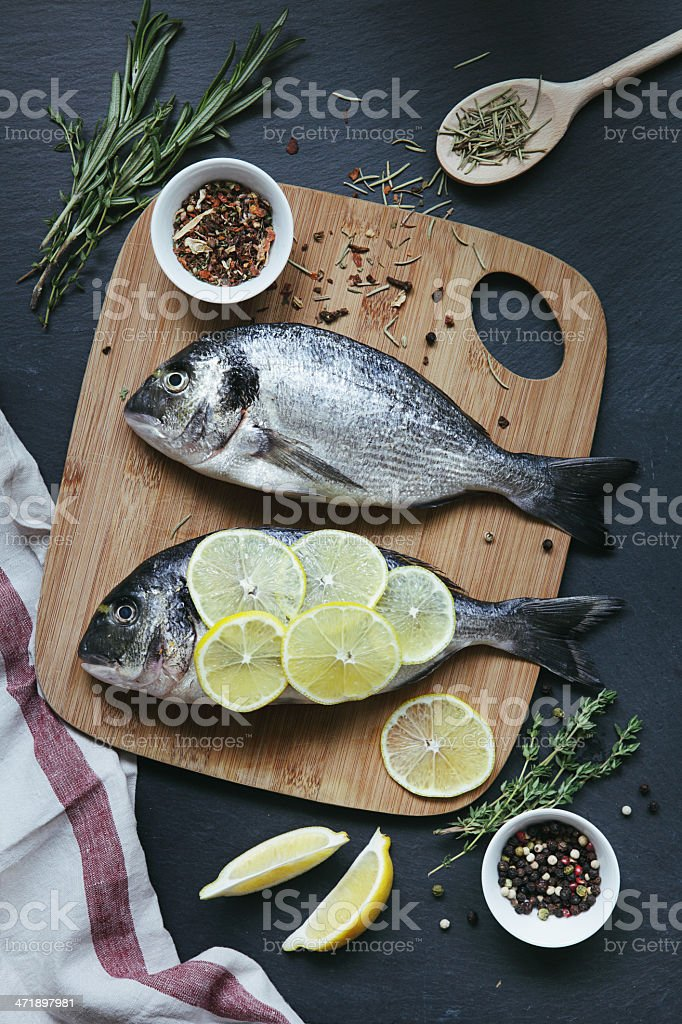 Dorado with lemon and spices royalty-free stock photo