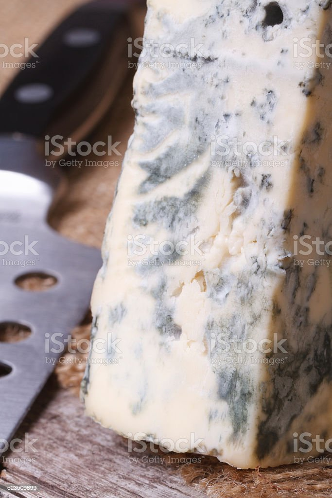 Dorblu cheese close up on an old wooden table stock photo