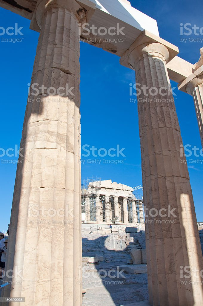 Doric Columns with Parthenon on the background. Athens, Greece. stock photo