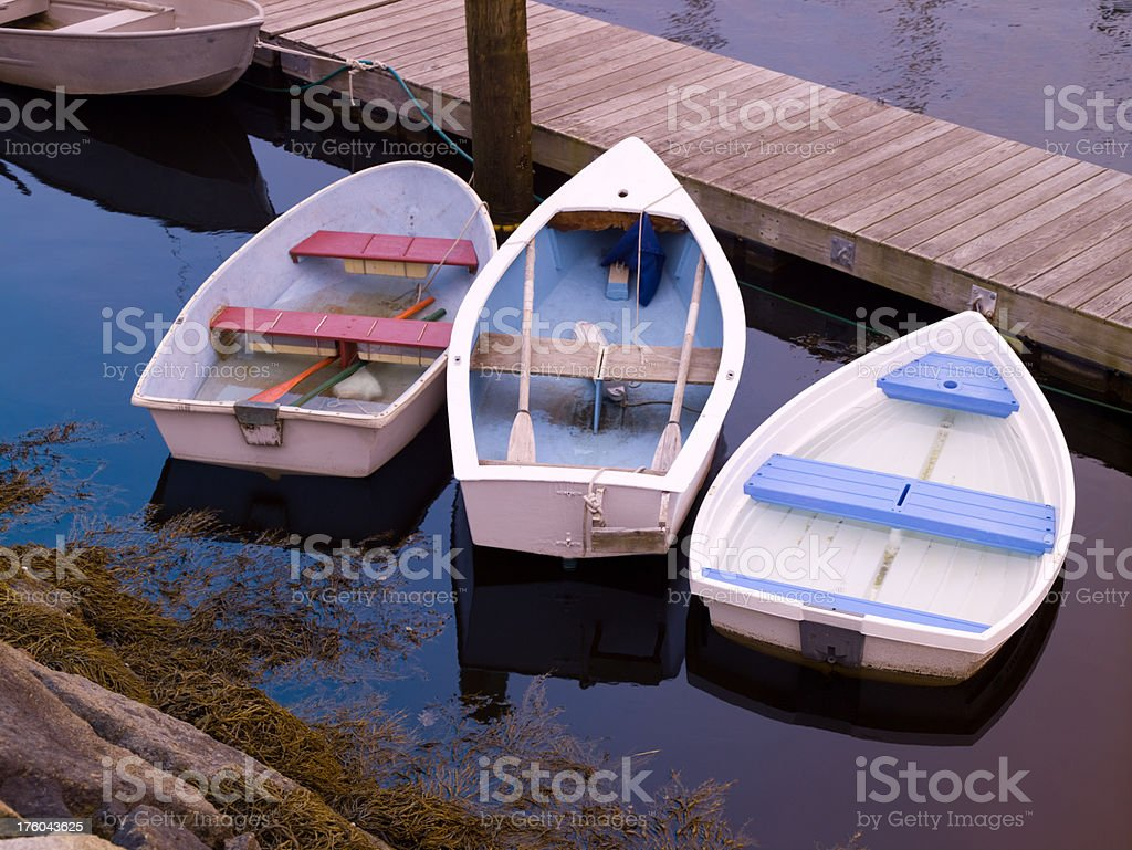 Dories tied at dock stock photo