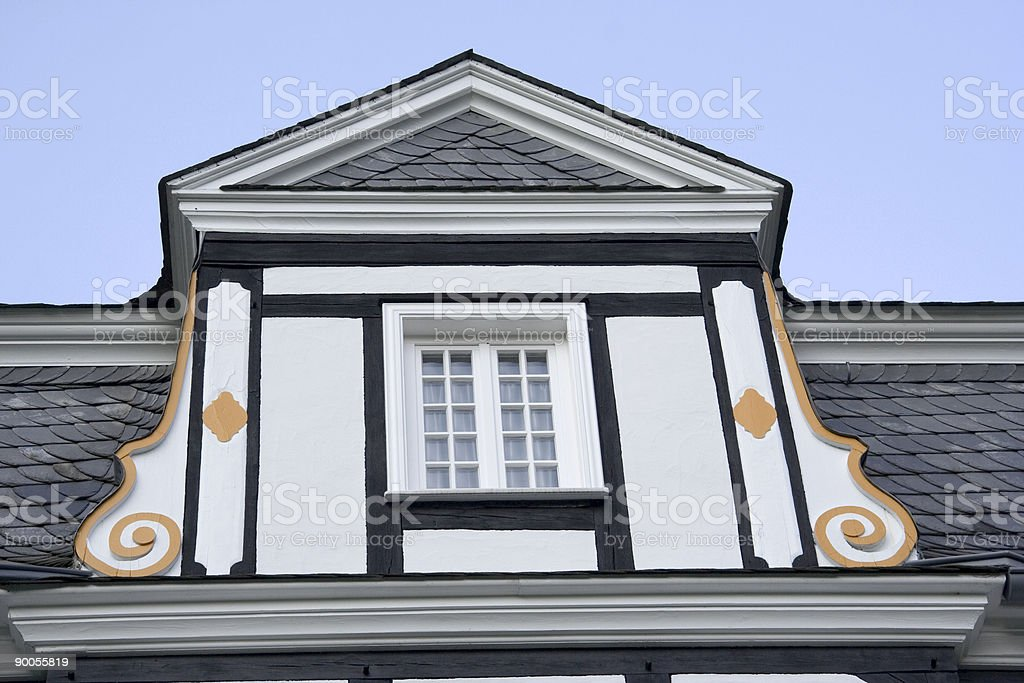 dormer window of a halftimbered mansion with slated roof stock photo
