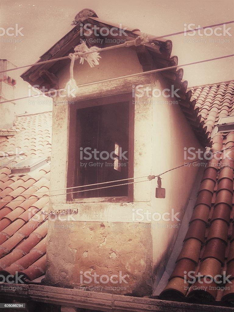 Dormer Window, Tile Roof, Clothes Line, Sepia Photograph stock photo