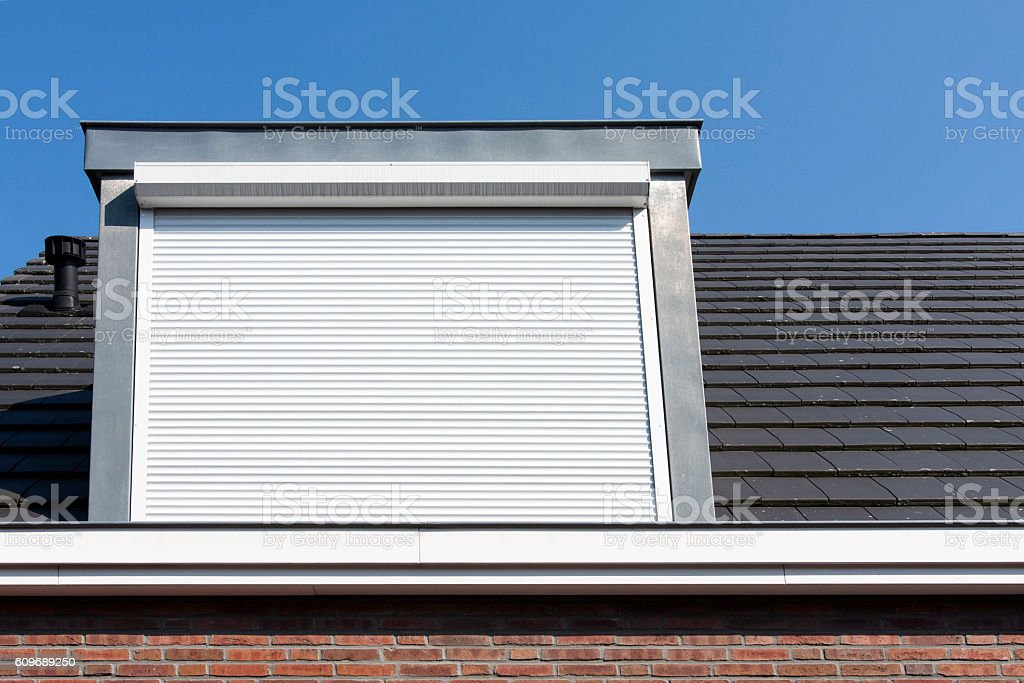 Dormer window with rolling safety  shutter stock photo
